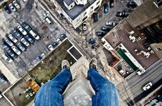 Daredevil photographer takes pictures of his feet dangling off tall buildings
