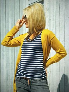 I like the super bright cardigan combined with stripes.