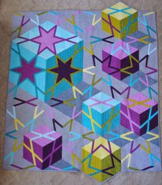 """Pattern is in """"Amazingly Simple Triangle Stars"""" book by Barbara Cline"""