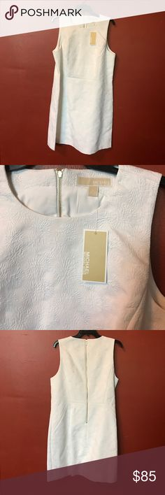 NWT MICHAEL KORS DRESS Knee length Michael kors white dress.  No yellowing of material.  Nice pattern all over dress.  Dress was stored in dust bag.  Bought for white party but did not attend.  Dress never used. Michael Kors Dresses