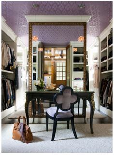 Amazing closet with a vanity for putting on makeup or accessorizing with jewelry.