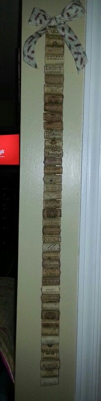 Wine corks, I pin all my local business cards here for quick reference. Made one for co worker and pinned lottery tickets to it for a great birthday gift.