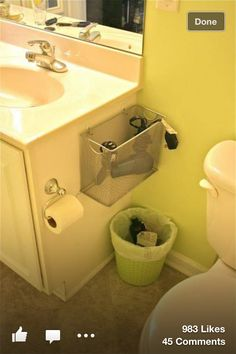 DIY storage for bathroom- spray the silver to bronze to blend better with our décor and cabinet color.