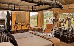 Horseback Safari - Singita Grumeti Reserves  Canvas, steel and leather-clad en suite tents by the South African interior designers, Cécile & Boyd.