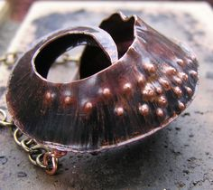 Fold formed copper seed pod necklace with freshwater pearls. $69.00, via Etsy.