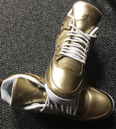 Check Out These Gold Air Jordan 4 Cleats Made For Childhood Cancer Awareness Day
