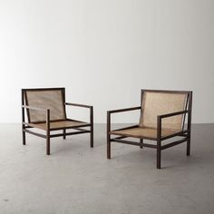 "R & Co. Joaquim Tenreiro, Brazil Pair of lounge chairs in jacaranda with cane seats. 28"" L x 23.34"" W x 28"" H"