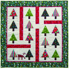 The Norwegian Wood quilt uses our Cool Yule and Metallic Christmas collections by Makower UK. Click here to download the pattern.