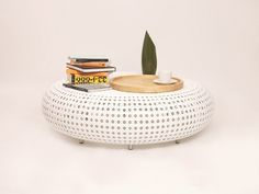 Round Table Bench  is A coffee table that also acts as a bench, round spacious, a combination of modern design with synthetic rattan weaving, suitable for both indoor and outdoor.