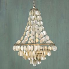 "Natural Shell Necklace Chandelier - 3 Lt.Strands of pearl shaded shells attach to the antique silver frame on this shell chandelier. A different take on the popular ""capiz"" look, this one has a classic feel that won't go out of style. 3x40 watts. (24""Hx16""W)    Product SKU: CH10008 SL  Price:  $779.00"