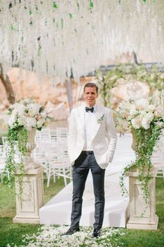 Cinematography: With Heart Films  Wedding Dress: Mira Zwillinger  Ceremony Venue: Vouliagmeni Lake  Reception Venue: Island Art & Taste  Bride's Shoes: Aquazzura  Catering: Aria Fine Catering  Groom's Attire: Tom Ford  Event Planning + Decor: Deplanv  Getting Ready Venue: Astir P