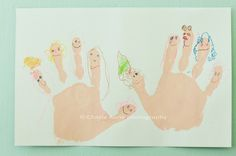 Paint your child's hand, let her make a print (or two) and when the paint is dry color your family members on each finger!