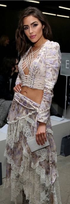 Who made Olivia Culpo's tie top, lace skirt, boots, and white clutch handbag?
