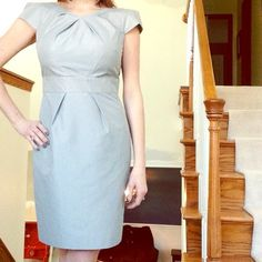 Silver Knee Length BR Cap Sleeve Dress Gorgeous Banana Republic dress, the light metallic sheen of the gray fabric makes it easy to dress up or down. It's great for an office or even a nice night out. I wore it to a summer wedding, but it doesn't fit me anymore. It's unlined and the cotton/poly fabric doesn't have any stretch so please be sure that you're a true size two!!! Please comment with any questions or if you want the measurements :) Banana Republic Dresses Midi