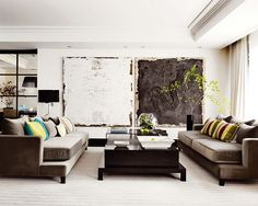 Luv the scale and the texture of these art pieces!! Great living room!!