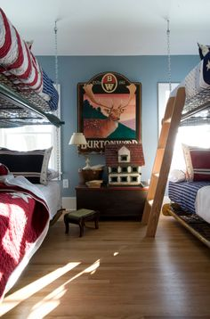 antique box frames, hung on chains, make up this very cute bunkroom for the lake house!
