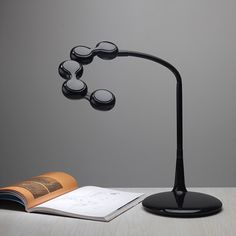 Freestyle LED Desk Lamp by zelco: With 4 heads, and adjustable, extendable arm, 60 white LEDs and three brightness settings, this puts the light where you want it. Unique Table Lamps, Cool Lamps, Led Desk Lamp, Lighting Design, Lights, Cool Stuff, Home Decor, Craft Desk, Global Market
