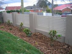 Cement the Surroundings - Who says that the American dream of the white picket_fence# has to have a wooden_fence#? Create a dream_fence# with thick one-foot concrete newel posts. Insert narrow horizontal wood planks between the newel posts to create a cool contrast.