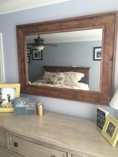 This rustic wooden frame will look great in a bedroom, living room, or family room. The mirror will make an artistic statement over a dresser, mantel, or buffet.