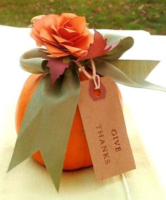 "Thanksgiving Favors...mini pumpkins decorated with a sweet bow & rose and a ""Give Thanks"" tag.  How cute for each place setting!"