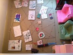 Kids artwork displayed in the play-room! My husband used twine and nails.