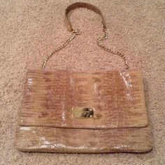 Michael Kors large clutch Michael Kors taupe colored reptile purse/clutch. Very versatile.  REASONABLE OFFERS using the OFFER BUTTON will be considered.  10% off for BUNDLES only. ❌No Trades ❌No PayPal ❌Please don't advertise your closet on my listing Bundle to save on shipping Questions, please ask!❌No Trades ❌No PayPal ❌Please don't advertise your closet on my listing Bundle to save on shipping Questions, please ask! Michael Kors Bags