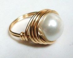 Swarovski Pearl Ring Large White pearl ring wrapped in gold filled wire. This is a large glass Swarovski pearl approximately It is difficult to catch the complete beauty of this Swarovski pearl in pictures. Gold Pearl ring makes a wonderful anniversary or Gold Pearl Ring, Gold Band Ring, Solitaire Rings, Jewelry Rings, Silver Jewelry, Silver Rings, Diy Rings, Jewelry Holder, Silver Bracelets