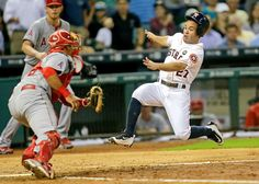 Out at home -  Jose Altuve (right) of the Houston Astros is out at home while trying to score during a game against the Los Angeles Angels on Sept. 21 in Houston. -  © Bob Levey/Getty Images