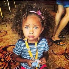 Gorgeous little girl with pretty eyes and curly hair