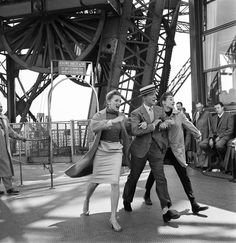 """Kay Thompson, Fred Astaire, and Audrey Hepburn perform """"Bonjour, Paris!"""" atop the Eiffel Tower for their film Funny Face, 1956 Fred Astaire, Juliette Binoche, Jodie Foster, Robert Doisneau, Jessica Biel, Tour Eiffel, Classic Hollywood, Old Hollywood, Photos Du"""
