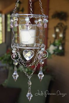 Chicken wire candle chandelier.  For more ideas visit my blog:  http://lindapetersondesigns.com