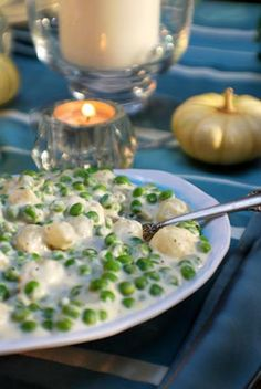 Peas and Pearl Onions in a creme sauce... I like to do this with new potatoes too