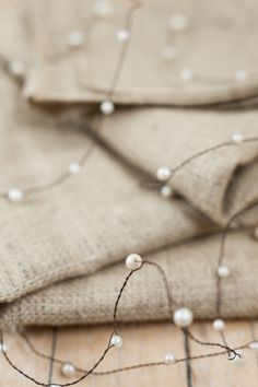 Pearl Beads on Wire Garland for DIY Rustic or Beach Wedding & Home Decor. So easy to do!! Pearl Centerpiece, Wedding Table Centerpieces, Flower Centerpieces, Wedding Decorations, Centerpiece Ideas, Floral Wedding, Diy Wedding, Rustic Wedding, Wedding Beach
