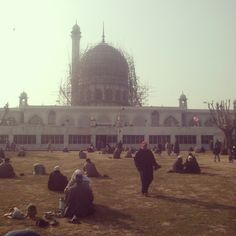 People sitting in the shrine vicinity after Friday Prayers & Salaam