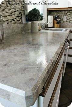 Did this once and it lasted for 3 years till I could afford all new countertops.   Hometalk :: How To Paint Your Counters