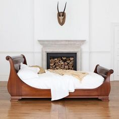 Manoir hand carved luxury wooden sleigh bed   andsotobed.co.uk
