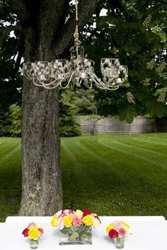 Hang an old chandelier in a tree outside.  A great idea I saw on Home by Novogratz (one of my favorite shows!)