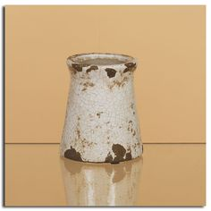 We love this crackle ceramic line Example: country chic ceramic 5 x 5 canister  $7.29 Available at Oddity Store