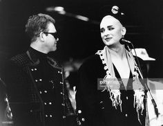 Singers Elton John (left) and Boy George on stage together, at a Prince's Trust concert, Wembley Stadium, London, June 9th 1987.