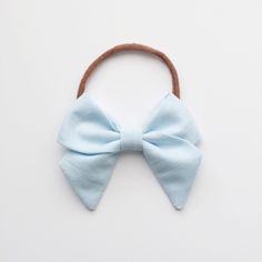 Hand-folded cotton bow.Sewn to prevent fray, hand-folded, and attached to either a one size fits all nylon band or alligator clip. 3 sizes, small, medium, and large. Small: 2 inches wideMedium: 3 inches wideLarge: 3.5 inches wideFOR A BUNDLING DISCOUNT:Before checkout, type the number of hand-folded bows (any size) you have in your cart into your code box to reveal your discount! Ex: If you have 3 hand-folded bows in your cart enter the code: THREEIf you've...