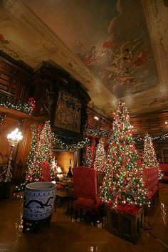 """Biltmore House Library---A first edition copy of Charles Dickens """"A Christmas Carol"""" is on display in the library. The rich colors and textures of the book binding will be repeated in the colors of the ornaments decorating the four trees, garlands and wreaths in this room."""