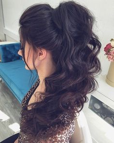 Long Curly Ponytail With A Bouffant