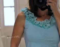 Adding a little girly-girl to an old tee shirt! - Used a scarf for the strip of material to create the ruffle!!