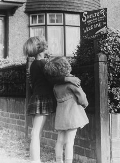 sisters look up at a sign outlining the dangers in the event of an air-raid! The Blitz, Air Raid, World War Two, Looking Up, Ww2, Vintage Photos, Britain, Retro Vintage, History