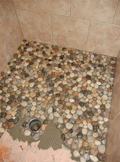 Instead of using tile in her bathroom, she decided to use pebbles from the dollar store! The results are better than you could ever imagine.