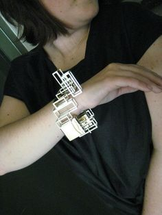 "Christine Bukkehave -   ""Building site"" 18kt gold, silver, 0,03ct diamond"