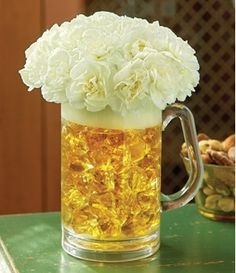"Oktoberfest party decorations: Beer mug filled with amber-colored acrylic rocks. White mini carnations form the ""foam. Oktoberfest Party, Super Bowl Party, Gold Wrapping Paper, Pink Flower Arrangements, Cha Bar, Fathers Day Presents, 40th Birthday Parties, 30th Birthday Ideas For Men Surprise, Ideas Party"