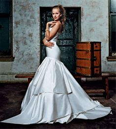 Dazzle your guests in this diamond-white, Italian silk-satin wedding dress featuring a drop waist and buttons down the back, about $7,500, by Romona Keveza. Also available in pearl white and ivory. Faux-pearl bracelet, $60, by Miriam Haskell, at Jest Jewels.