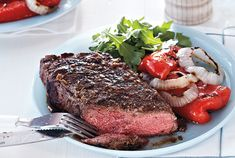 Horseradish Strip Loin With Grilled Peppers-----Strip loin steaks are an inexpensive option for a simple meal, but you can substitute any other cut of grilling steak. Use a large metal spatula when turning the onions on the grill to prevent them from falling apart.