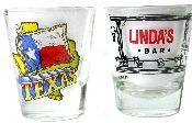 Texas Shot Glasses - Pair featuring Linda's Bar and Texas. One glass is imprinted with the Texas flag and the other with Linda's Bar. The shot glasses are in mint condition.